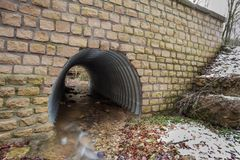 Water tube under the road Stock Photo