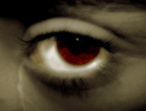 The Ardent Eye. It is an eye , with a sadness expression. A red eye , with a tear going down from it Stock Photography
