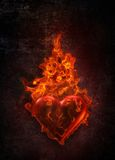 Ardent heart. In flame on grunge background Royalty Free Stock Image