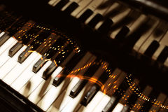 Ardent notes. Pianoforte keyboard with fingers shadow & ardent notes, musical fantasy Royalty Free Stock Photos