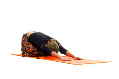 Ardha Kurmasana, a position in Yoga, is also called   Half Tortoise Pose Stock Images