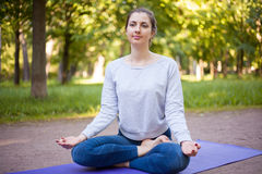 Ardha Padmasana yoga pose Royalty Free Stock Photos