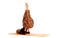 Ardha sarvangasana, a position in Yoga, is also called  half shoulder stand Royalty Free Stock Photos