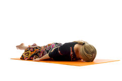 Ardha shalabhasana , a position in Yoga, is also called Half Locust Royalty Free Stock Photography