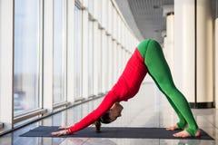 Ardha shirshasana. Beautiful yoga woman practice in a big window Stock Photos