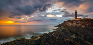 Ardnamurchan Panorama. Lighthouse on cliffs of Ardnamurchan Point in colorful sunset, Highlands, Scotland stock images
