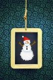 Ardoise accrochée de Noël Images libres de droits