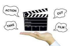 Ardoise de film sur la main humaine Photographie stock libre de droits