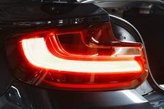 Ardore posteriore dell'automobile del faro Automobile moderna di lusso di affari di sport fotografie stock libere da diritti