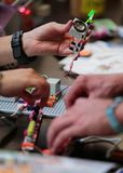 People handle arduino components in a workshop at sonar barcelona. Arduino sound electronics masterclass at sonar festival in barcelona Royalty Free Stock Photo