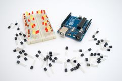 Arduino, transistors, protoboard with LED lined up. On a white background Royalty Free Stock Image