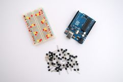 Arduino, transistors, protoboard with LED lined up. On a white background Stock Images