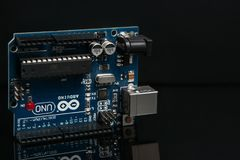 Arduino UNO board on black background Royalty Free Stock Image