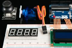 Arduino UNO board with electronic components Royalty Free Stock Image