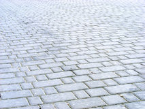 Area. The area is covered with paving slabs of rectangular shape Stock Photos