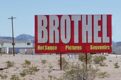 Area 51 Alien Center and Brothel. Roadside sign advertising the Area 51 Alien Center in Nevada not far from Death Valley NP, complete with a brothel next door Stock Photography