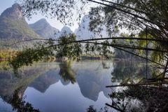 The Yulong River is a small tributary of the large Li River in Guangxi Zhuang Autonomous Region in China. The area around small town Yangshuo in Guangxi Zhuang Stock Photos
