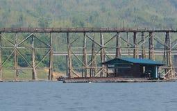 Area bridge old scenery has a raft and a mountain  in Sangklaburi Stock Photos