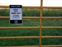 Area closed sign. Bison area, keep out, sign on a metal gate Stock Image