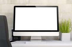 area di lavoro con il computer dello schermo in bianco Fotografia Stock