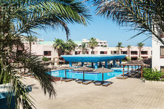 Area hotel with pool and palm trees in Hurghada. Egypt. Stock Photo