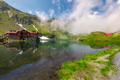 Area of lake Balea in clouds. Gorgeous summer landscape of Fagarasan mountains, Romania. popular tourist location Royalty Free Stock Image