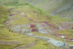 Area of Montana De Siete Colores near Cuzco. Tourists on Montana De Siete Colores near Cuzco. Seven colour mountain in Peru. Tourists climbing to the top stock photos