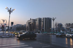 The area near Bucharest Courthouse from Unirii Boulevard at rush hour Stock Photography