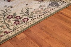 Area Rug. Close up of Area Rug and Hard Wood Floor royalty free stock photos