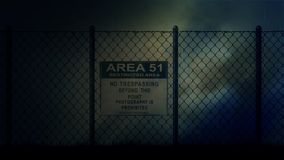 Area 51 Sign on a Metal Fence on a Stormy Night