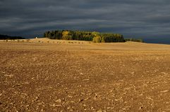 Area and storm clouds. Mowed field and dark storm clouds Stock Image