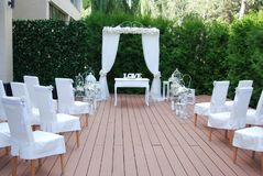 Area of the Wedding Ceremony, Decorated with White Flowers. Beautiful Arch, White Chairs Decorated with flowers. Area of the Wedding Ceremony, Decorated with Stock Photos