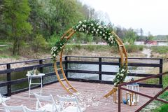 Area of the wedding ceremony in forest, near river on the pier. Royalty Free Stock Images