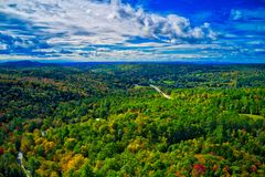 Areal Dramatic sky over new Hampshire fall foliage stock photos