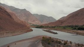Panj River and Pamir Mountains, Panj Is Upper Part of Amu Darya River. Panoramic View, Tajikistan and Afghanistan Border stock footage