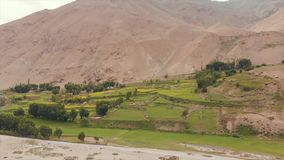 Panj River and Pamir Mountains, Panj Is Upper Part of Amu Darya River. Panoramic View, Tajikistan and Afghanistan Border. Areal Dron Shoot View of the Pamir stock footage