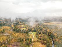Areal photo of Lithuanian country side on a foggy day. In autumn Stock Photos