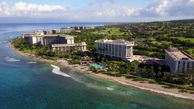 Areal photography of the beach of island maui,wonderful resort hyatt and beautiful nature under blue cloudy sky on stock video