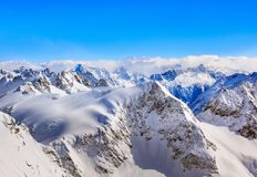 Areal Photography Of Snow Coated Mountains Under Clear Blue Sky stock images