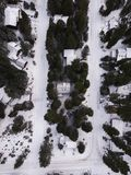 Areal Photography of Snow Covered Houses Surrounded by Green Trees Stock Photo