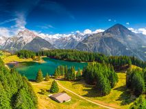 Areal view of Arnisee with Swiss Alps. Arnisee is a reservoir in the Canton of Uri, Switzerland, Europe. Arnisee with Swiss Alps. Arnisee is a reservoir in the royalty free stock photo