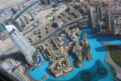 The areal view of the downtown Dubai. The view from the top of Burj Khalifa the world's tallest building over the downtown Dubai and the Sheikh Zayed road with Royalty Free Stock Images