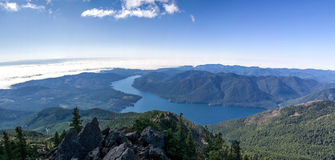 Areal View of Green Mountain Near Body of Water Under White and Blue Sky Royalty Free Stock Photos
