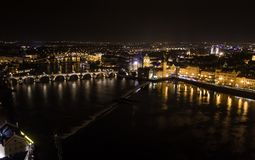 Areal view of Prague at night with the Charles Bridge in the middle. Areal view of Prague at night with the Charles Bridge in the middle of the Picture stock photo