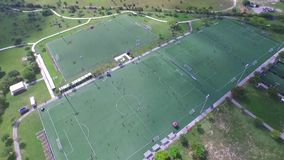Areal view of soccer fields with people playing. stock footage