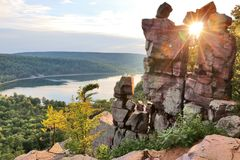 Beautiful Wisconsin summer nature background. Areal view on the South shore beach and lake from rocky ice age hiking trail during sunset. Devil& x27;s Doorway royalty free stock photography