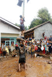Areca tree-climbing race to commemorate Indonesia's independence day Stock Photos