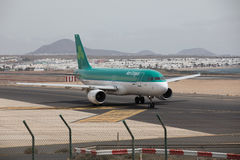 ARECIFE, SPAIN - APRIL, 15 2017: AirBus A320 of Aer Lingus at La. ARECIFE, SPAIN - APRIL, 15 2017: AirBus A320 of Aer Lingus ready to take off at Lanzarote royalty free stock photos