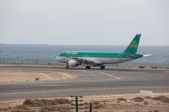 ARECIFE, SPAIN - APRIL, 15 2017: AirBus A320 of Aer Lingus at La. ARECIFE, SPAIN - APRIL, 15 2017: AirBus A320 of Aer Lingus ready to take off at Lanzarote royalty free stock photography