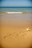 Areia 2012 limpa da mensagem escrita à mão Imagens de Stock